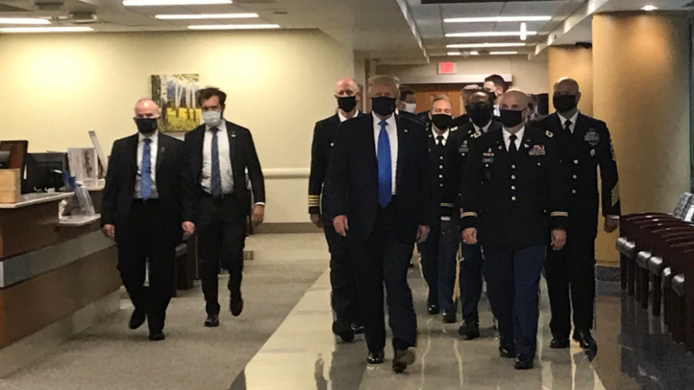 Trump wears a face mask for the first time in public during a visit to a military hospital